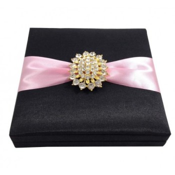 Black silk invitation box with golden brooch and pink ribbon