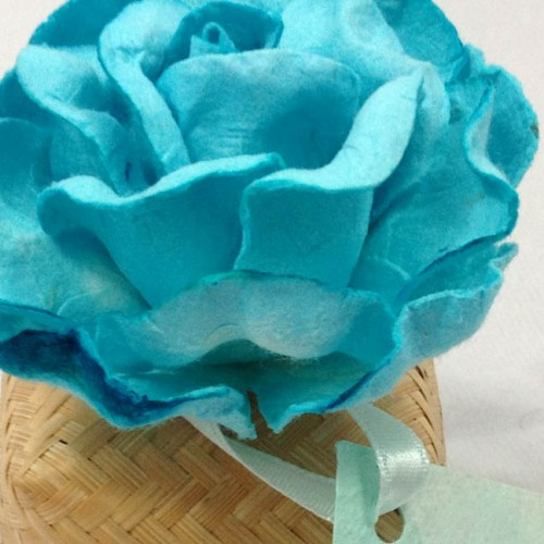 As paper flower embellished bamboo favor box