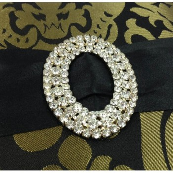 Large oval brooch in brocade silk with black ribbon
