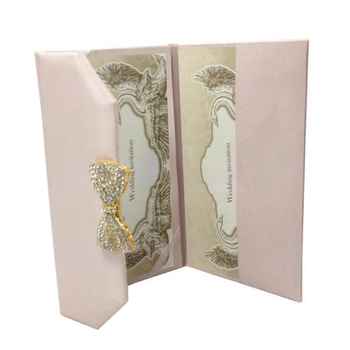 Opened silk envelope in blush pink with large crystal bow embellishment