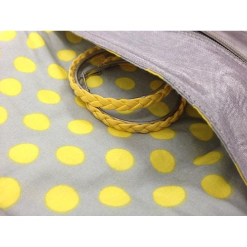 Pocket inside a silk and cotton polkadot jewellery roll