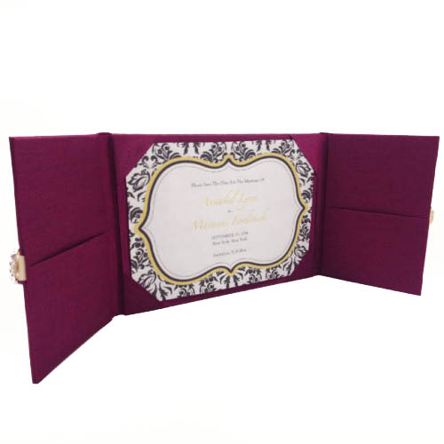 Opened dark magenta silk folder with pockets and two doors