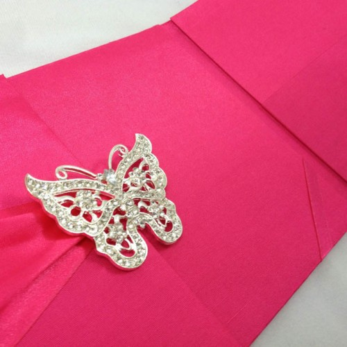 View of butterfly crystal brooch on silk folder