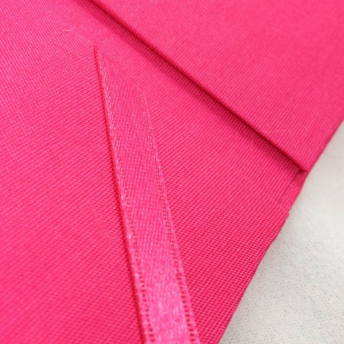 Detail view of ribbon holder of our deep pink pocket folder