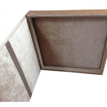 Opened lid of bronze wedding invitation box with velvet