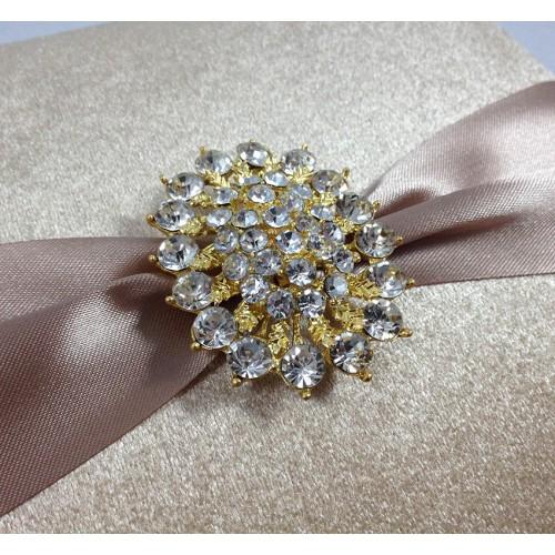 Golden rhinestone brooch on velvet box