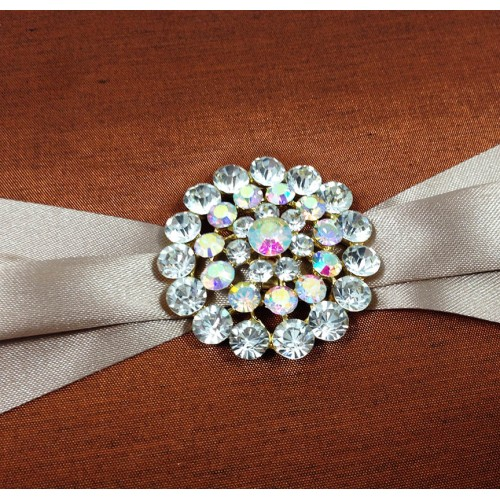 Rhinestone brooch on our bronze silk folder