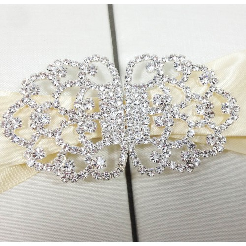 Luxurious rhinestone clasp on silk invitation