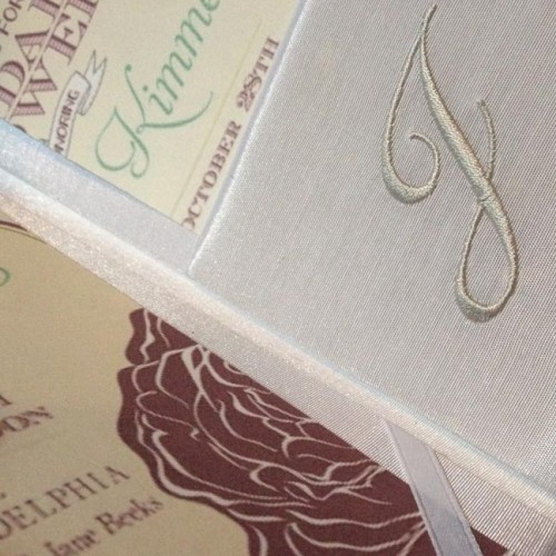 Detail view of a monogram embroidery inside on the pocket of our silk folio