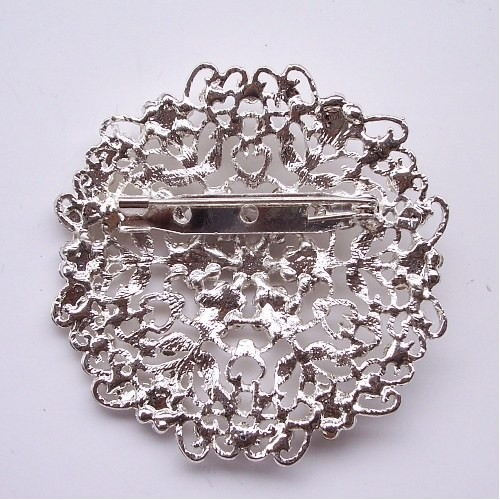 Flower crystal brooch, backside with stitch pin