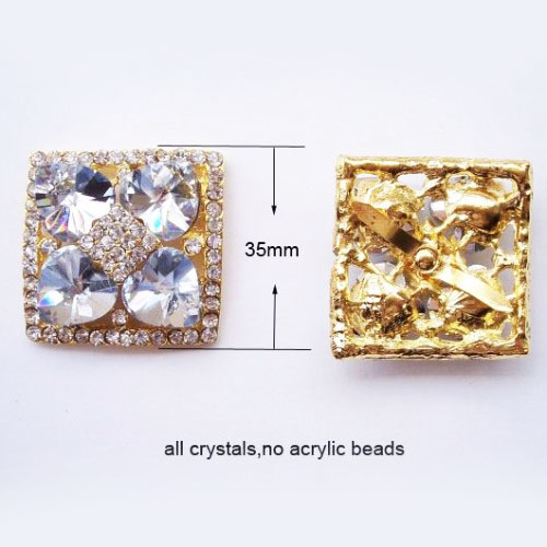 Golden brooch with rhinestone crystal in flower shape