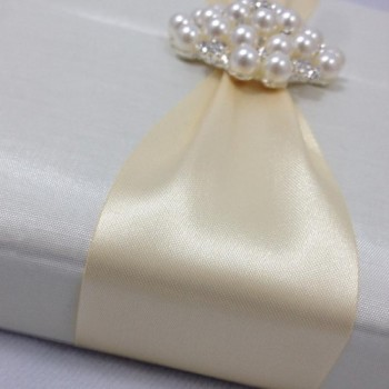 Pearl brooch embellished wedding invitation box