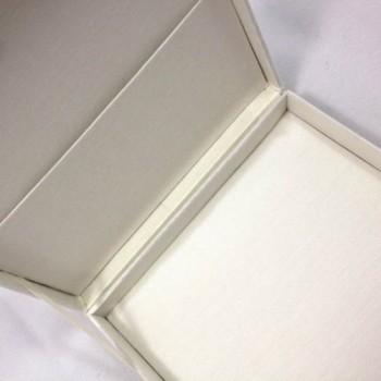 Pocket inside a silk invitation box with ivory silk