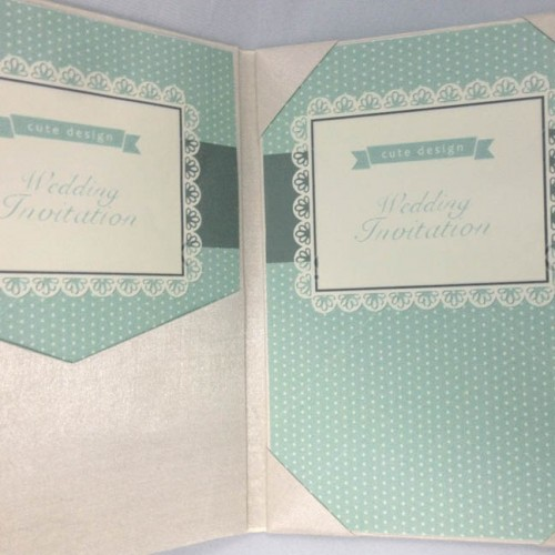 Picture of silk folio with mint color wedding invitation cards