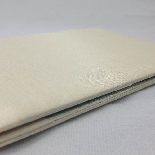 Picture of closed ivory silk folio with padding