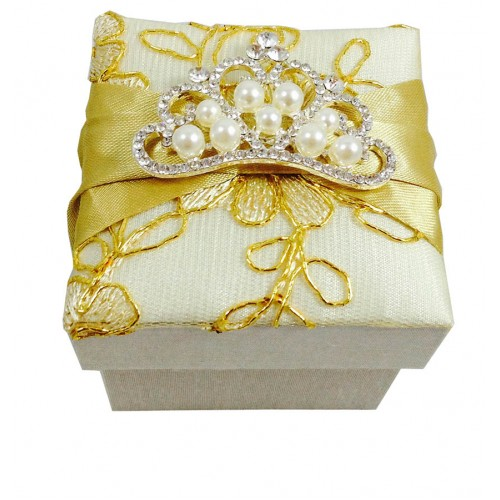 Lace covered golden wedding favor box with large pearl crown brooch