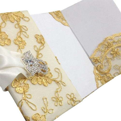 Picture of a silk folder with golden lace cover and silver plated crystal clasp