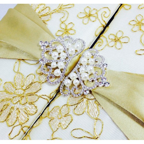 Pearl crown brooches of lace covered wedding box