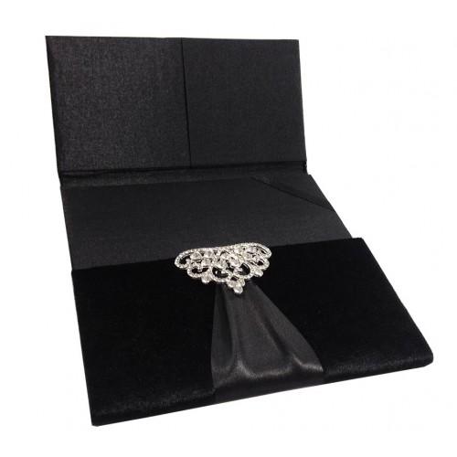 Opened black velvet folio invitation