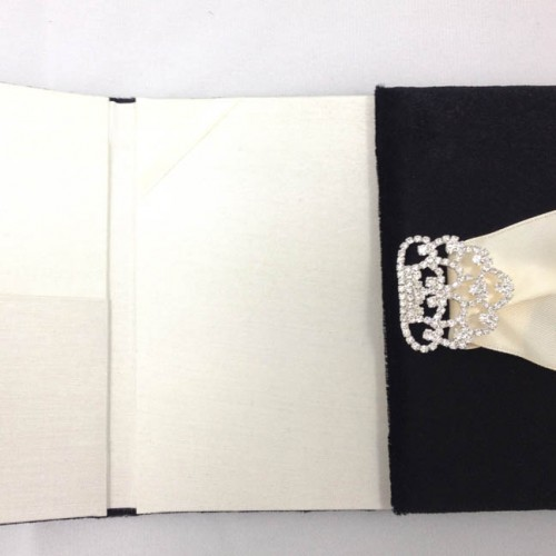 Ivory + black folio invitation with rhinestone brooch