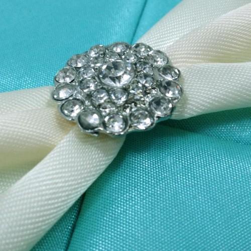 Small crystal brooch on aqua blue silk folder