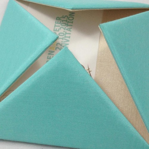 Aqua blue modern silk folio with brown embellishment and ivory ribbon