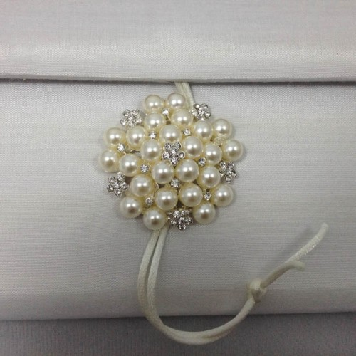 Large pearl brooch used to embellish our white silk envelope