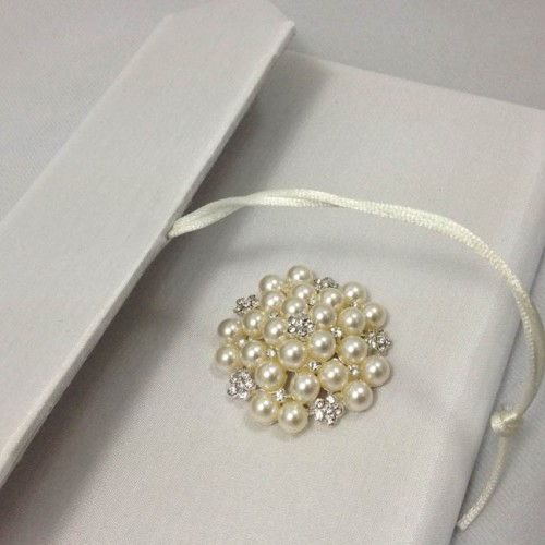 Luxury silk envelope with large pearl brooch embellishment and white silk cover
