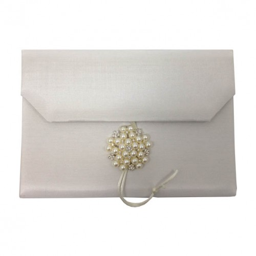 Outside view of luxury silk envelope with large pearl brooch