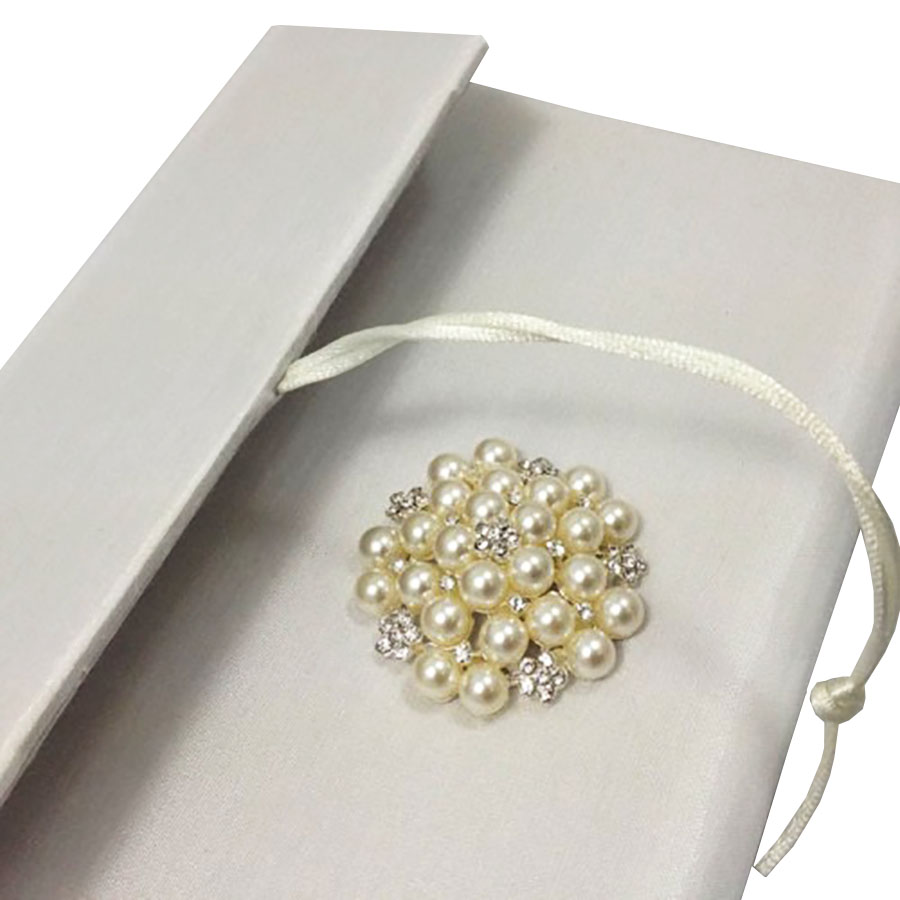 luxury silk invitation envelope with pearl brooch