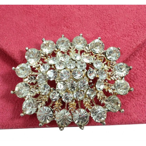 Close-up of rhinestone brooch with clear crystal
