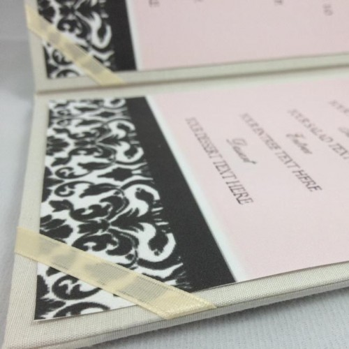 Menu card holder featuring silk and ribbon holder