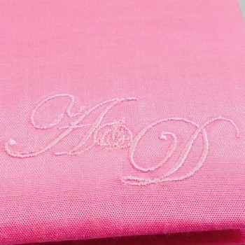 Monogram embroidery on silk