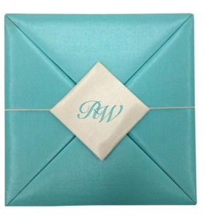 Ultra modern aqua blue silk folio invitation with monogram embroidered removable silk pad
