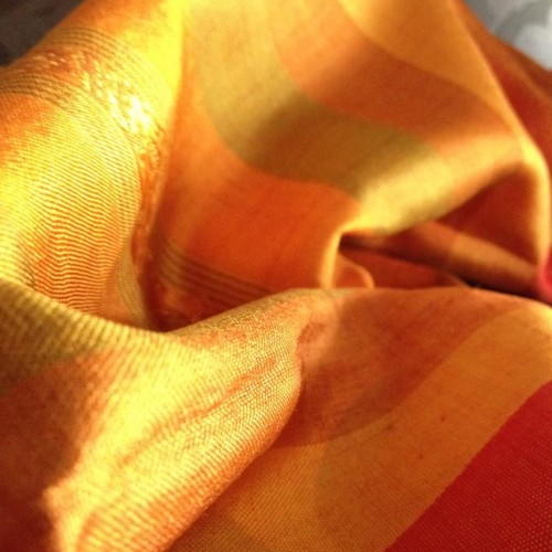 Picture of orange Thai silk shawl, muddle pattern