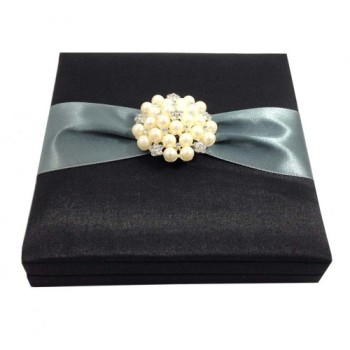 Embellished black faux silk wedding invitation box with large pearl brooch
