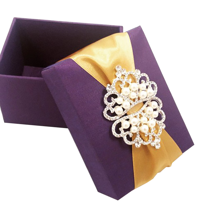 Purple silk favor box, embellished with pearl crown brooch