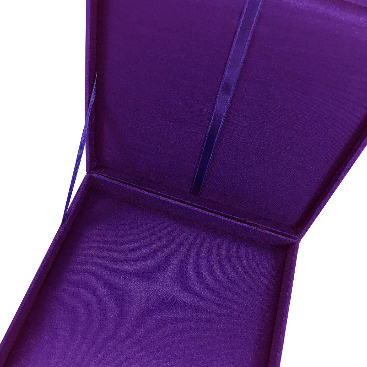 Interior of purple silk invitation box
