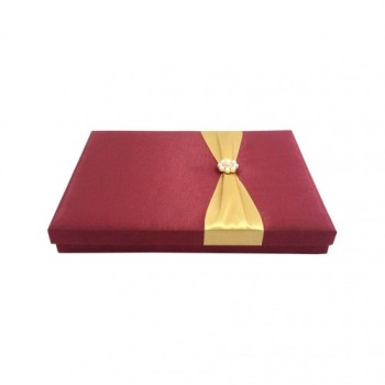 Red silk box with removable lid and gold ribbon bow with pearl brooch