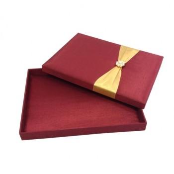 Opened red silk box