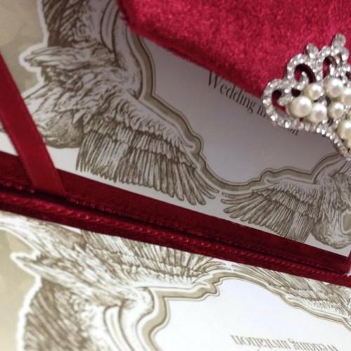 red velvet envelope opened with wedding invitation card
