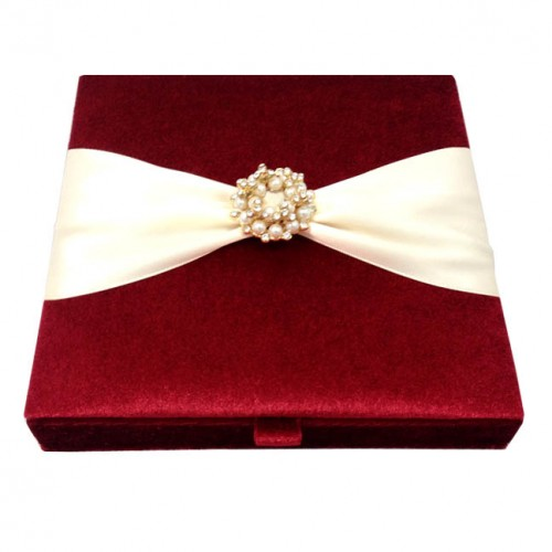 red velvet invitation box with pearl brooch embellishment