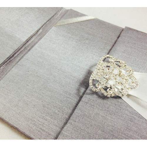 Embellished wedding invitations in silver