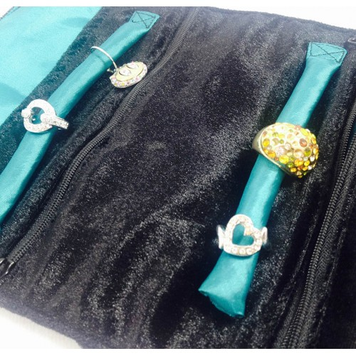 crystal things placed onto the ring holder inside a silk jewellery roll