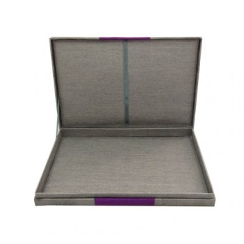 Opened silver hinged lid wedding invitation box with Thai silk
