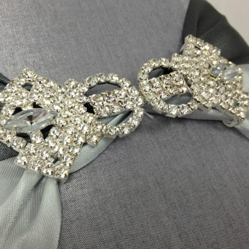 Rhinestone crystal clasp on silver silk box