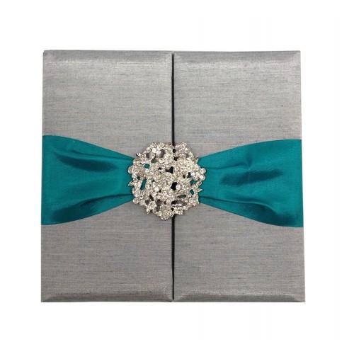 silver wedding folder with teal ribbon