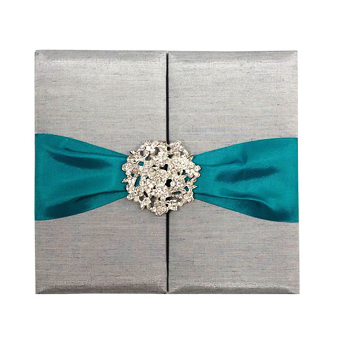 Grey folio with teal ribbon and brooch
