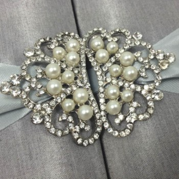 Silver pearl brooch in shape of a crown
