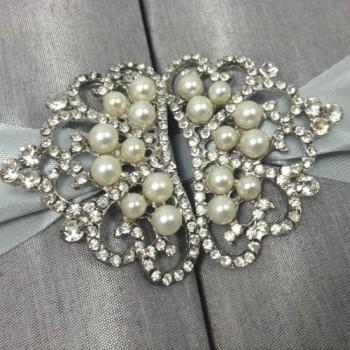 Silver pearl brooch in shape of a crown